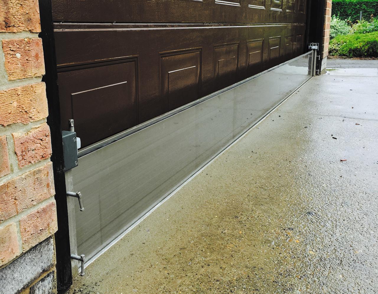 Garage door flood barrier floors doors interior design for Garage fence