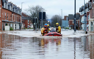 Rescue team floating down a flooded street