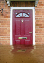 Flooded water up against a front door